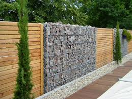 Decorative garden fence panels and walls with natural stone | Dolf ...